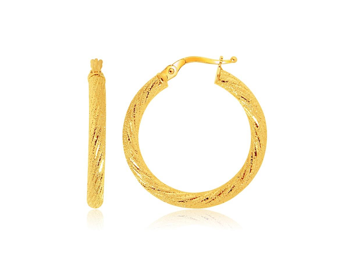 Medium hoop earrings in 14k yellow gold richard cannon jewelry